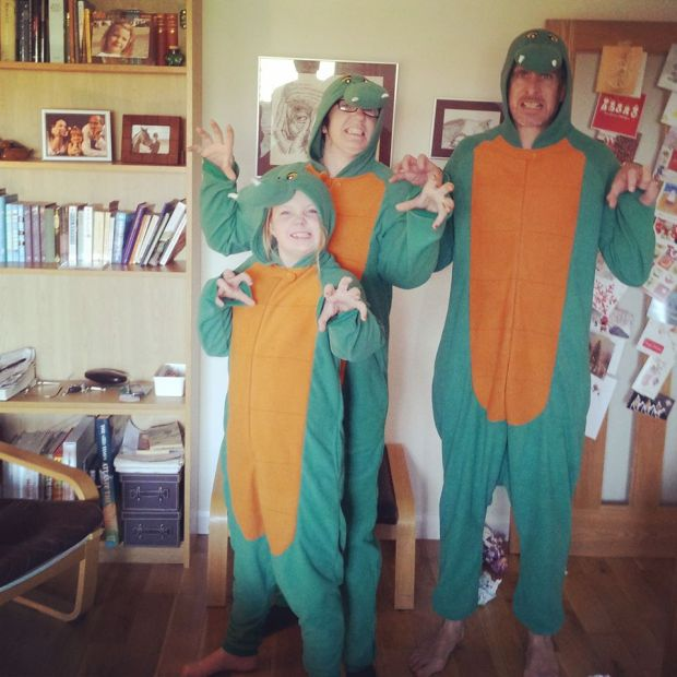 Family Neilson McLeod in full Dragon Onesie Glory